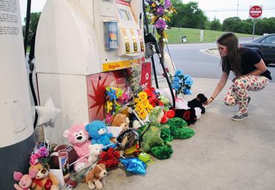 Memorial at gas pumps.