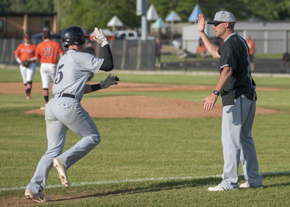 CJ Fairchild gets a high five from Coach Feltner after the home run.JPG
