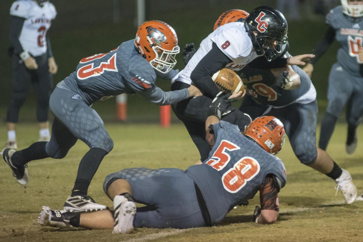 Dylan Ferguson gets ganged tackled by Raceland with Hayden Topping leading the charge.JPG
