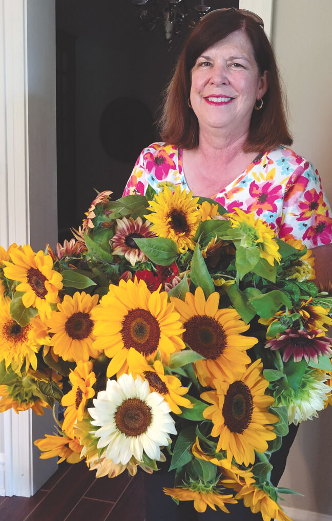 Love of flowers: Ashland woman turns swimming pool into garden full of blooms