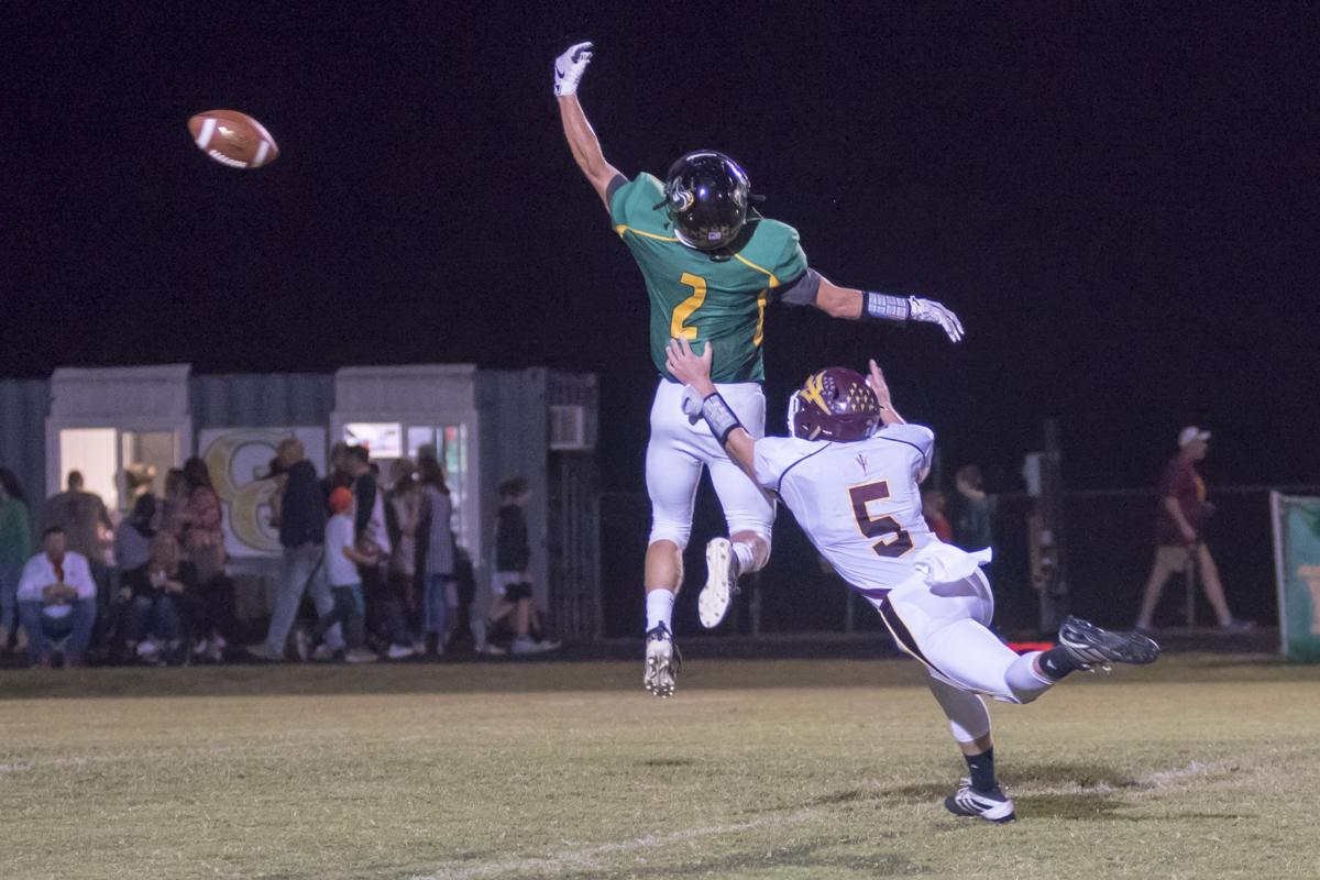 Austun Clarkson tries to make the grab as its sails over his head with Ethan Sharp in coverage.JPG