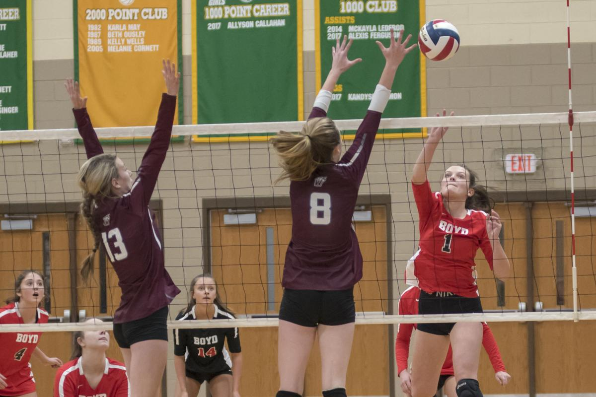 Morgan Lewis looks for a tip past Emily and Madison Adkins.JPG