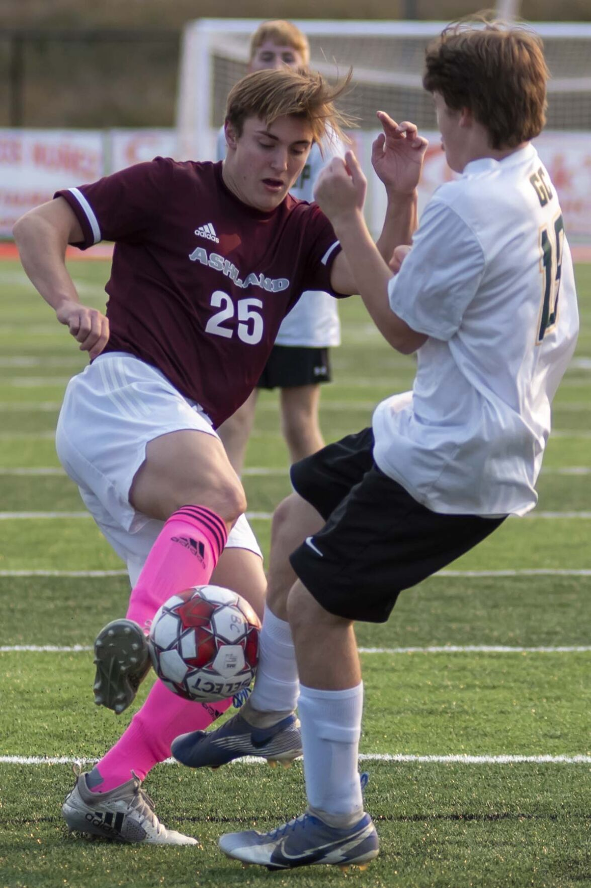 Calyx Holmes and Carter Gilliam battle for possession .JPG