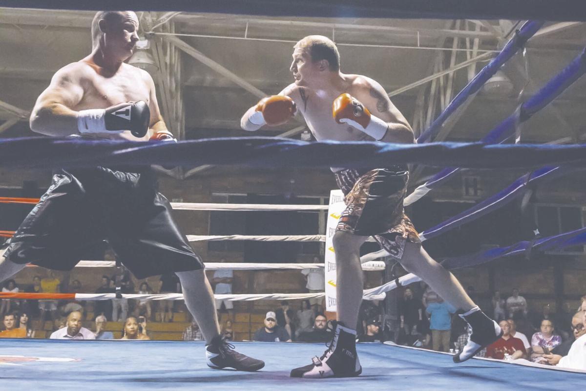 Travis 'Rattlesnake' Hanshaw takes a swing at Anthony Williams.JPG