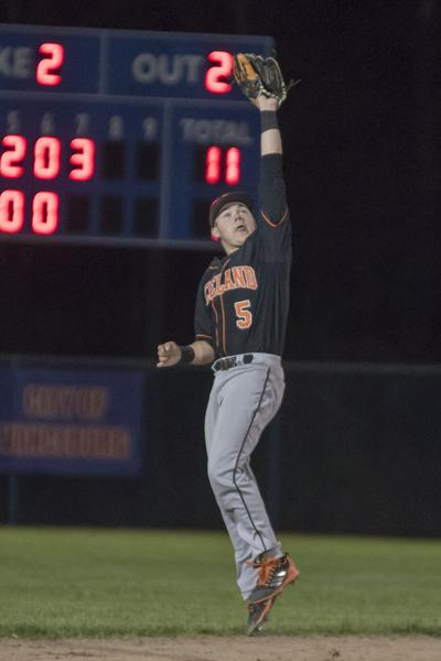 Seth Mills goes vertical for the final out of the game.JPG