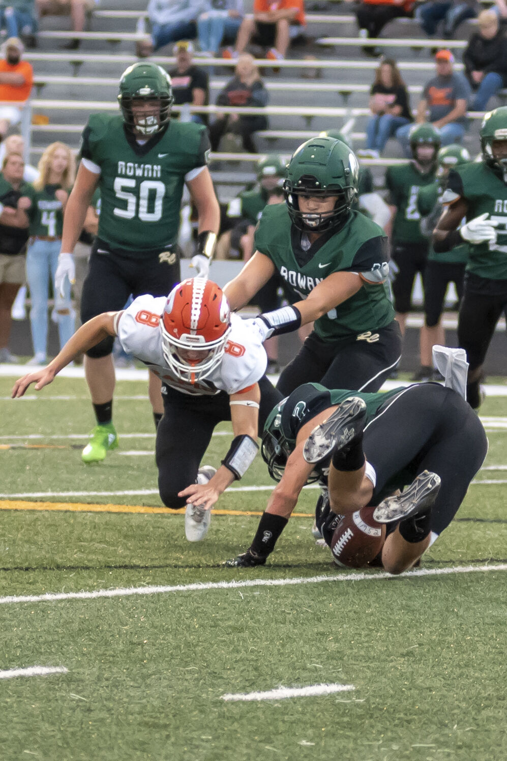 Conner Hughes dives for a loose ball as Rowan tries to maintain possession.JPG