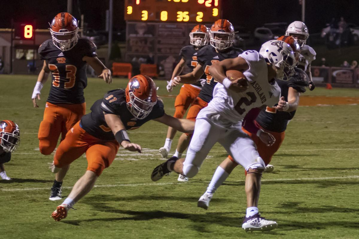 A Keontae Pittman breaking through a host of Racland players.JPG