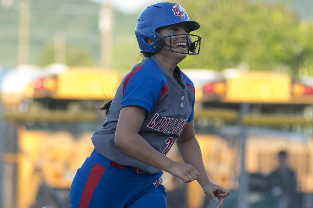 Alanna Puente is all smiles after a 3 run blast in the 6th.JPG