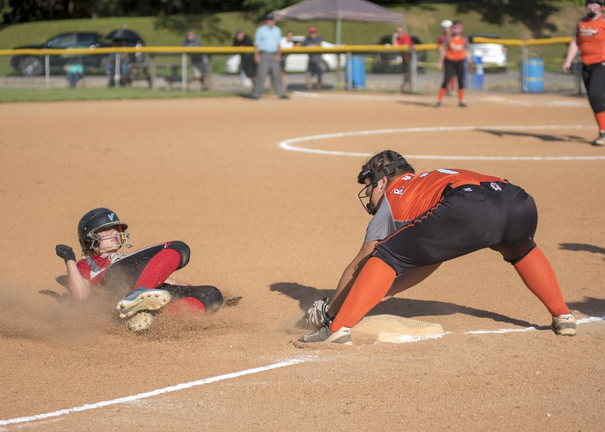 Jaycie Goad slides into the tag of Brooklyn Morris at 3rd for a double play.JPG