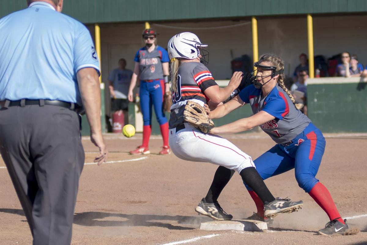 Cam Davidson makes contact with Halie Evans at 3rd as the throw comes in from behind.JPG