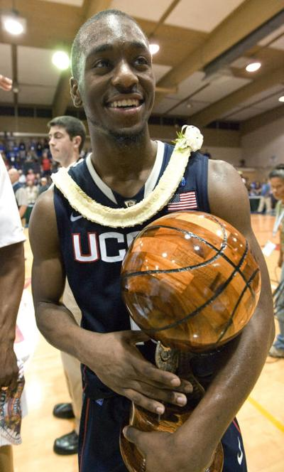 ... his trophy as the tournament's MVP after Connecticut defeated Kentucky 84-67 in an NCAA college basketball game to win the Maui Invitational in Lahaina, ...