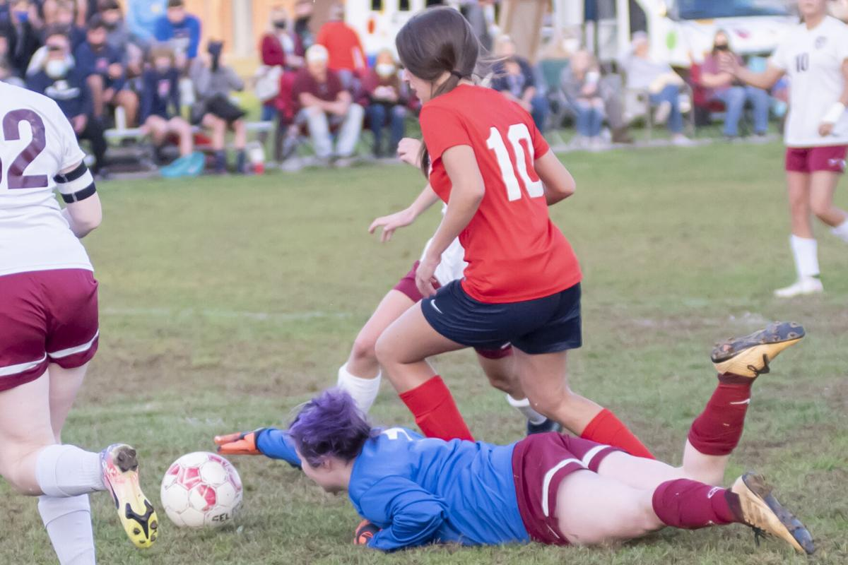 EG East Carter looks to score as Riley Madden looses her footing.JPG