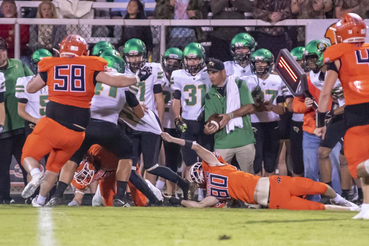 Cole Conlon hangs on for a stop of Braxton Noble.JPG