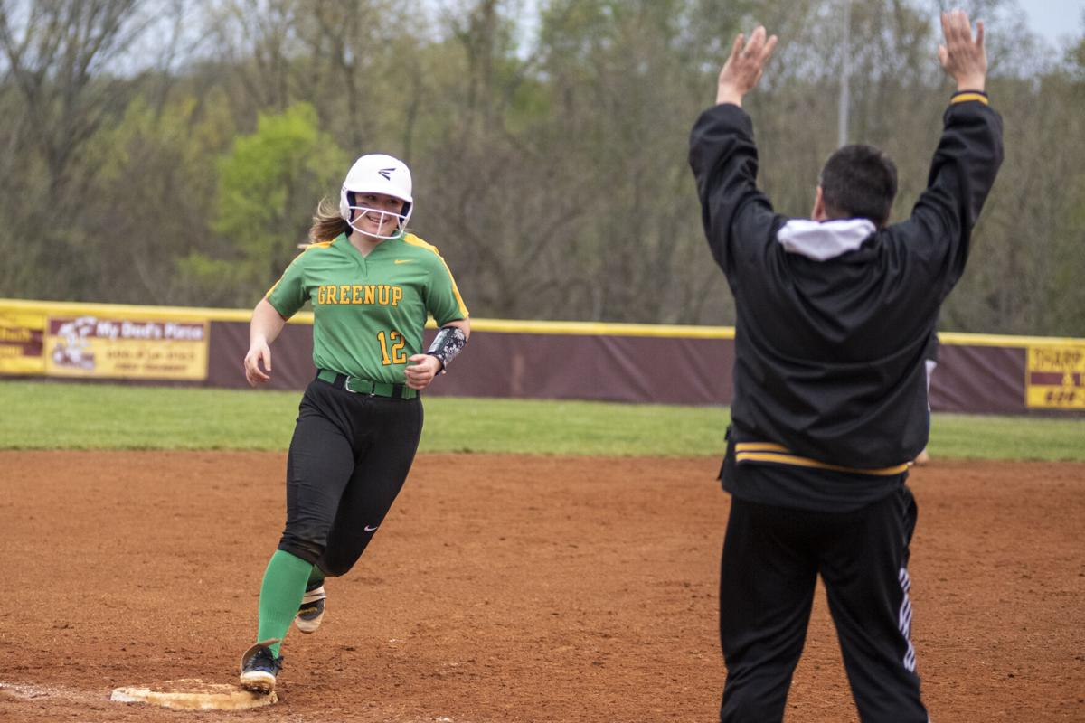 Skyler Lawrence rounds third after a blast for Greenup.JPG