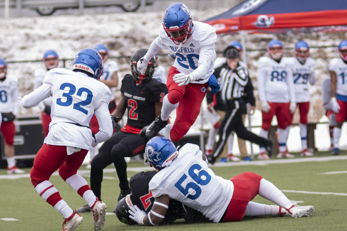 A Bluefield defender goes airborne after Brendan Ray hauls in a grab.JPG