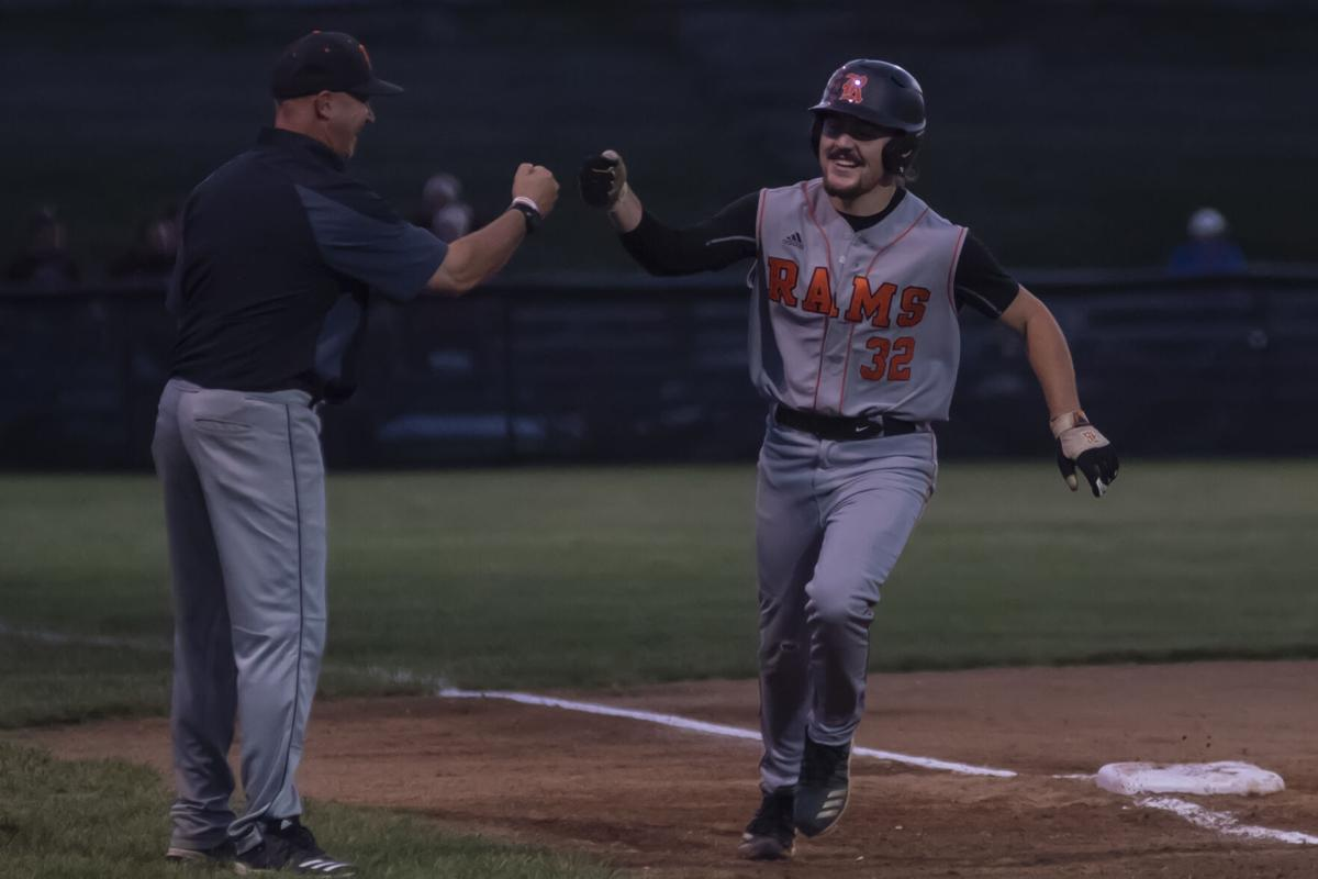Jake Heighton gets a fist bump from Mills after a homer in the first.JPG