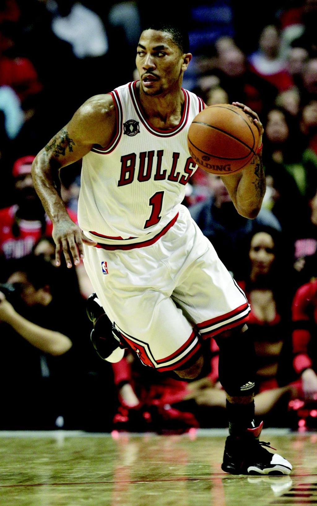 ed52e249dea4 Chicago Bulls point guard Derrick Rose brings the ball up against the  Indiana Pacers during the third quarter in Game 5 of a first-round NBA  playoffs ...