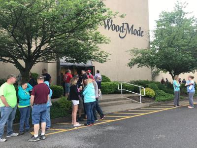 Ex-Wood-Mode employees pick up final check