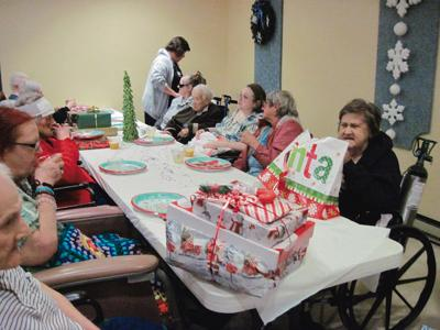 grandview nursing and rehabilitation residents prepare to open gifts during their annual party wednesday