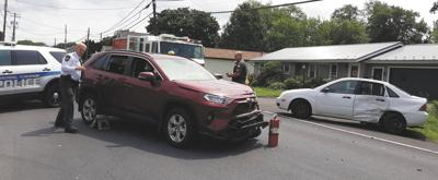 Children, man taken to hospital after two-vehicle crash