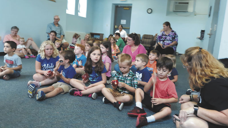 Kids learn about international instruments at library program