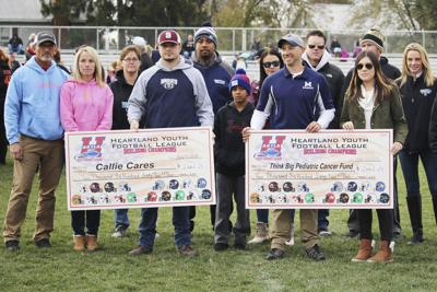 Heartland football gives to pediatric cancer nonprofits