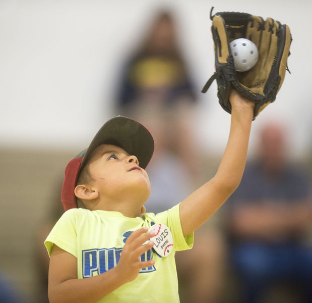 Instruction, learning continue at baseball clinic