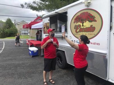 Meal program coordinator, insurance agent, food truck owner hold food giveaway