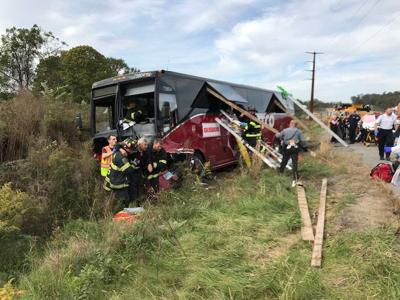 UPDATE: One dead after tour bus, pickup truck collide