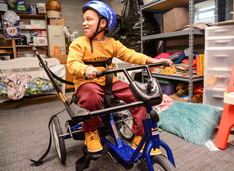 Students with disabilities receive adapted bikes