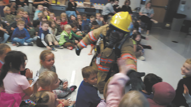 Firefighters visit schools, teach students about fire safety
