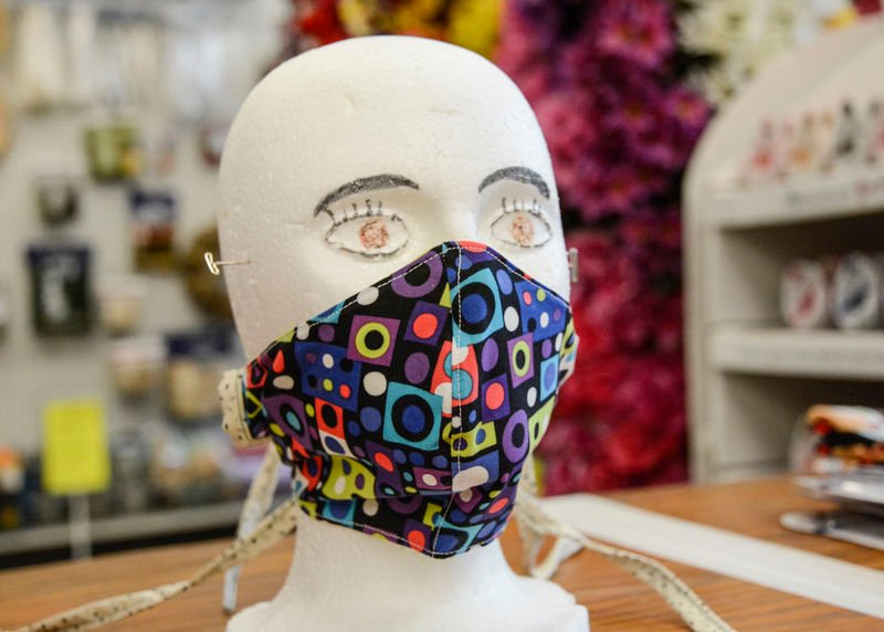 Local volunteers sewing face masks, donating them