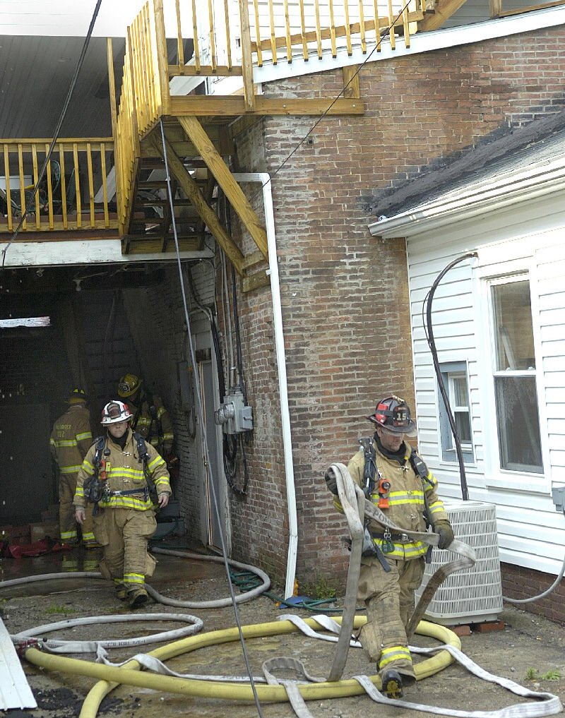 Firefighters work to keep a fire at
