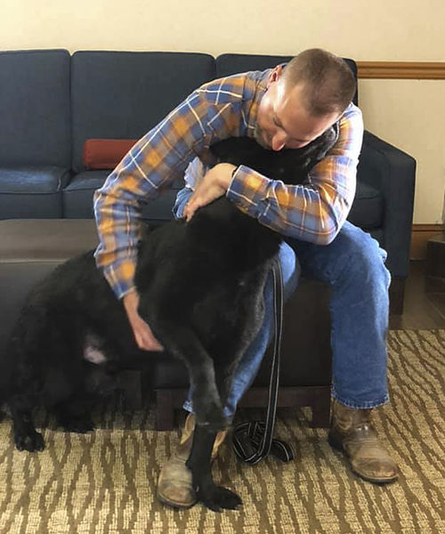 Veteran reunites with canine partner