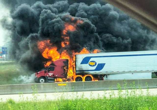Fire Starts At Front Of Semi Truck Trailer Loaded With Kit Kat Bars