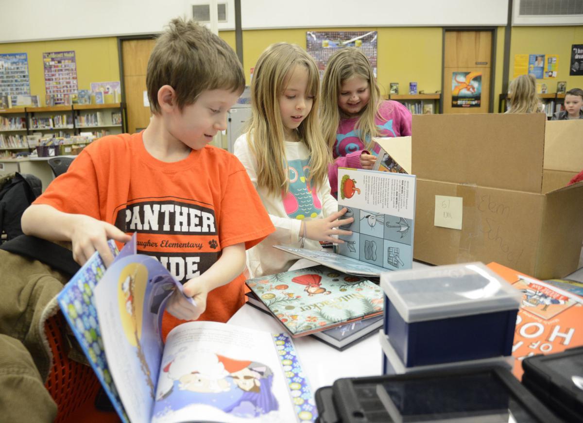 Store donates books to district