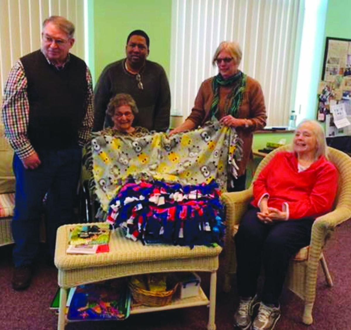 Members present blankets to Ronald McDonald House in