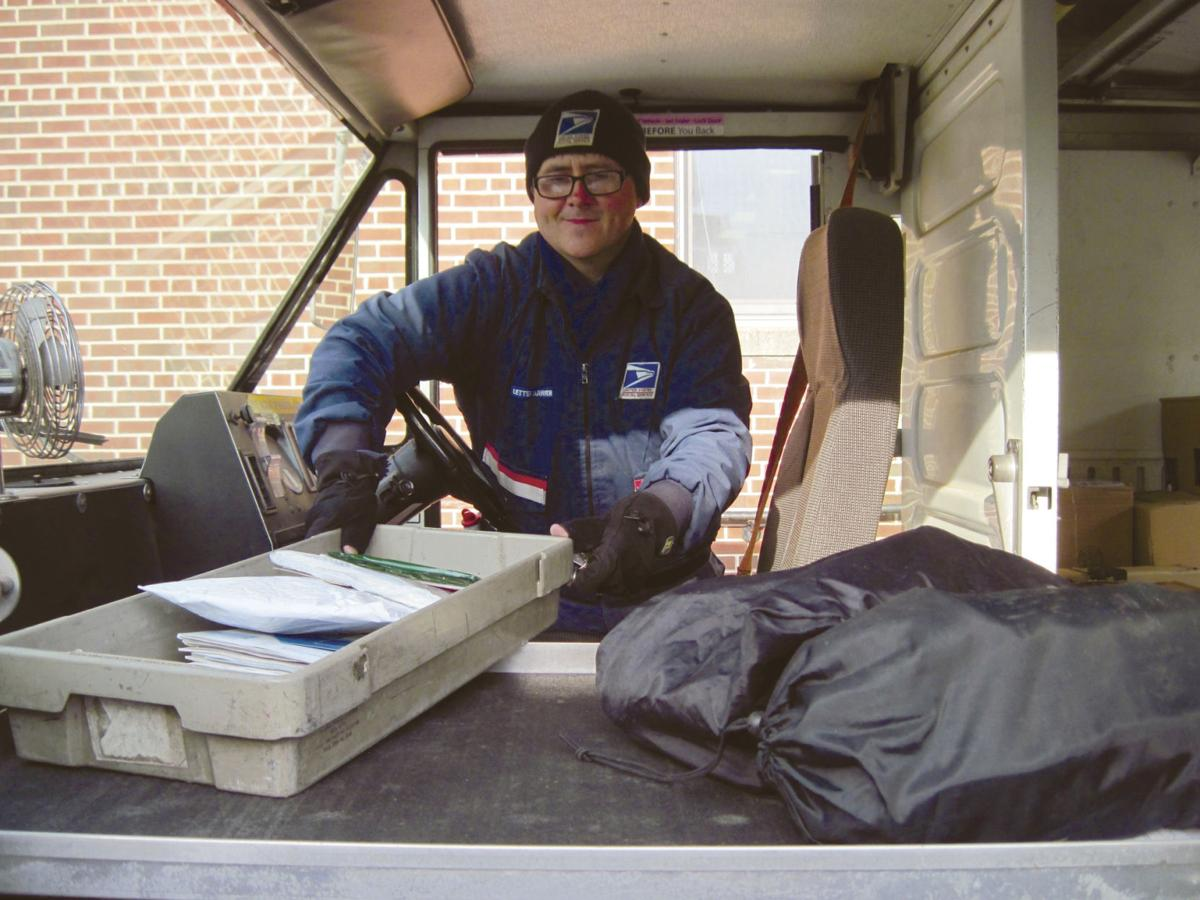 Joe Dorko loads a truck with mail before beginning deliveries Wednesday morning.