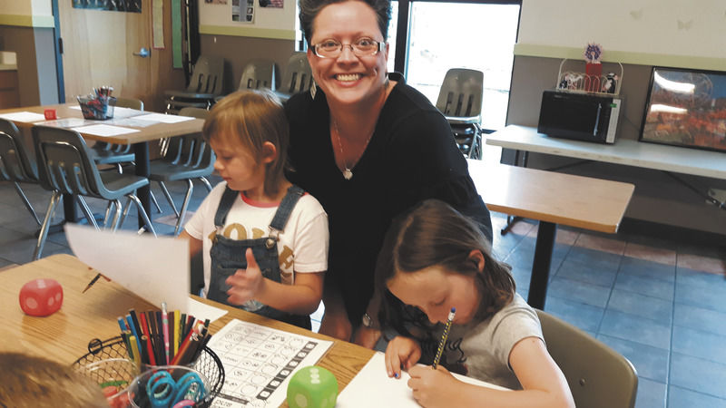 Summer camp participants draw monsters during Art Cart program