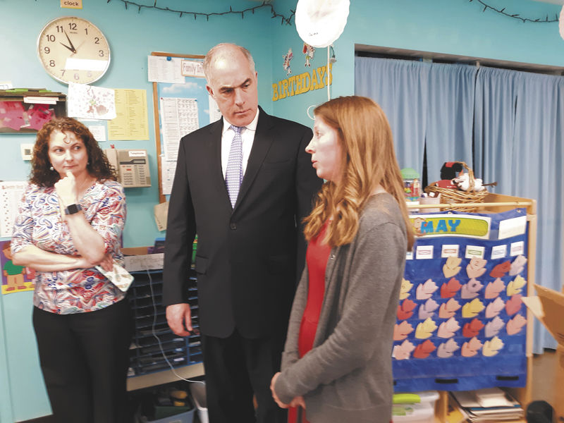 Casey visits daycare to assess child care costs