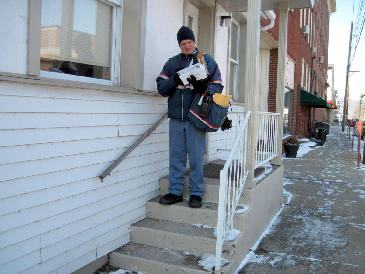 John Buggy prepares to make another mail delivery along East Mahoning Street in Danville Wednesday morning.