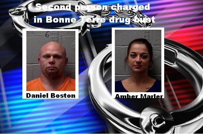 Second person charged in drug raid