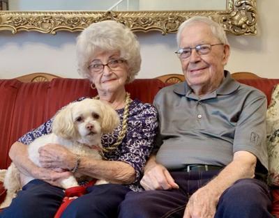 Couple celebrating 70th anniversary, husband's 90th birthday