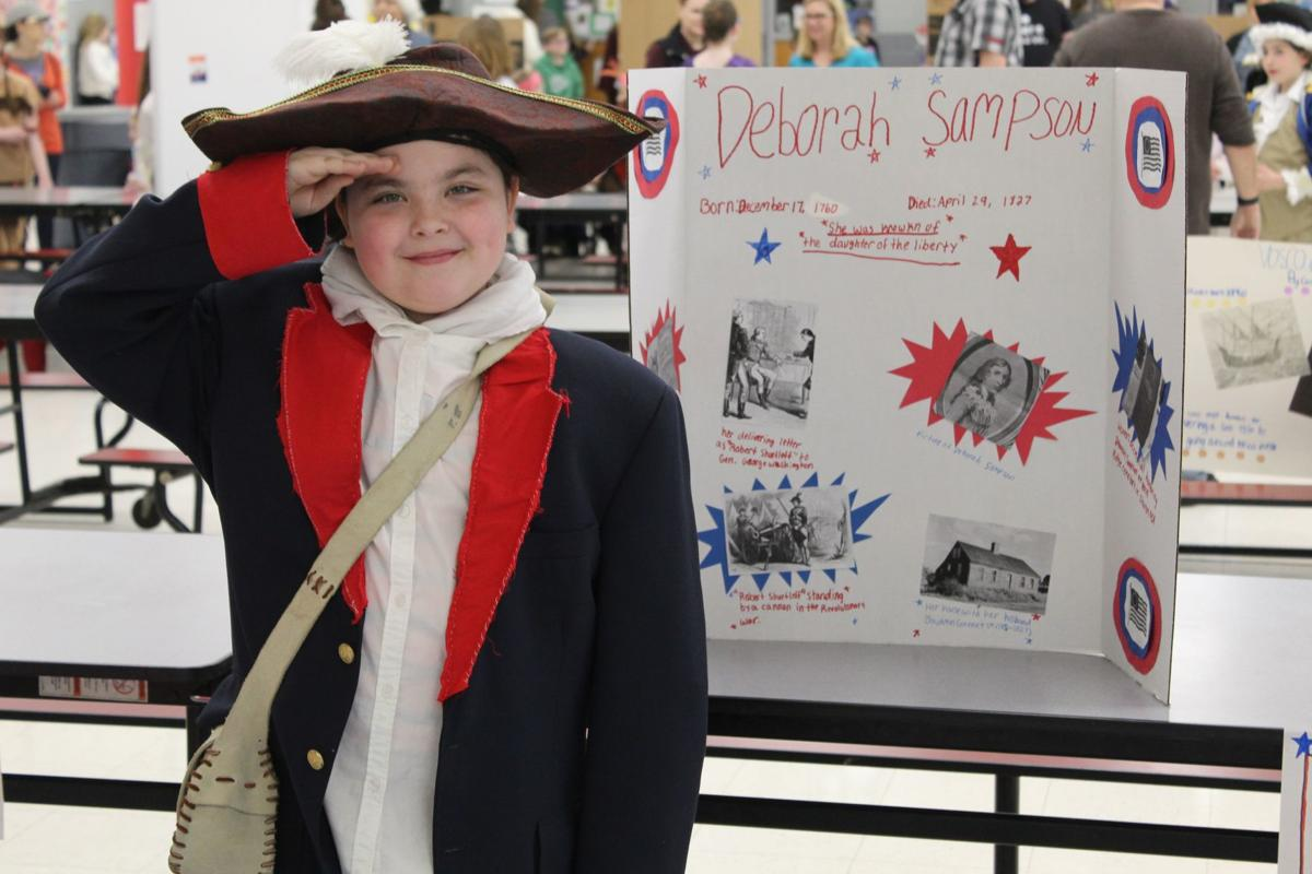 ROOSEVELT STUDENTS HOLD LIVING WAX MUSEUM