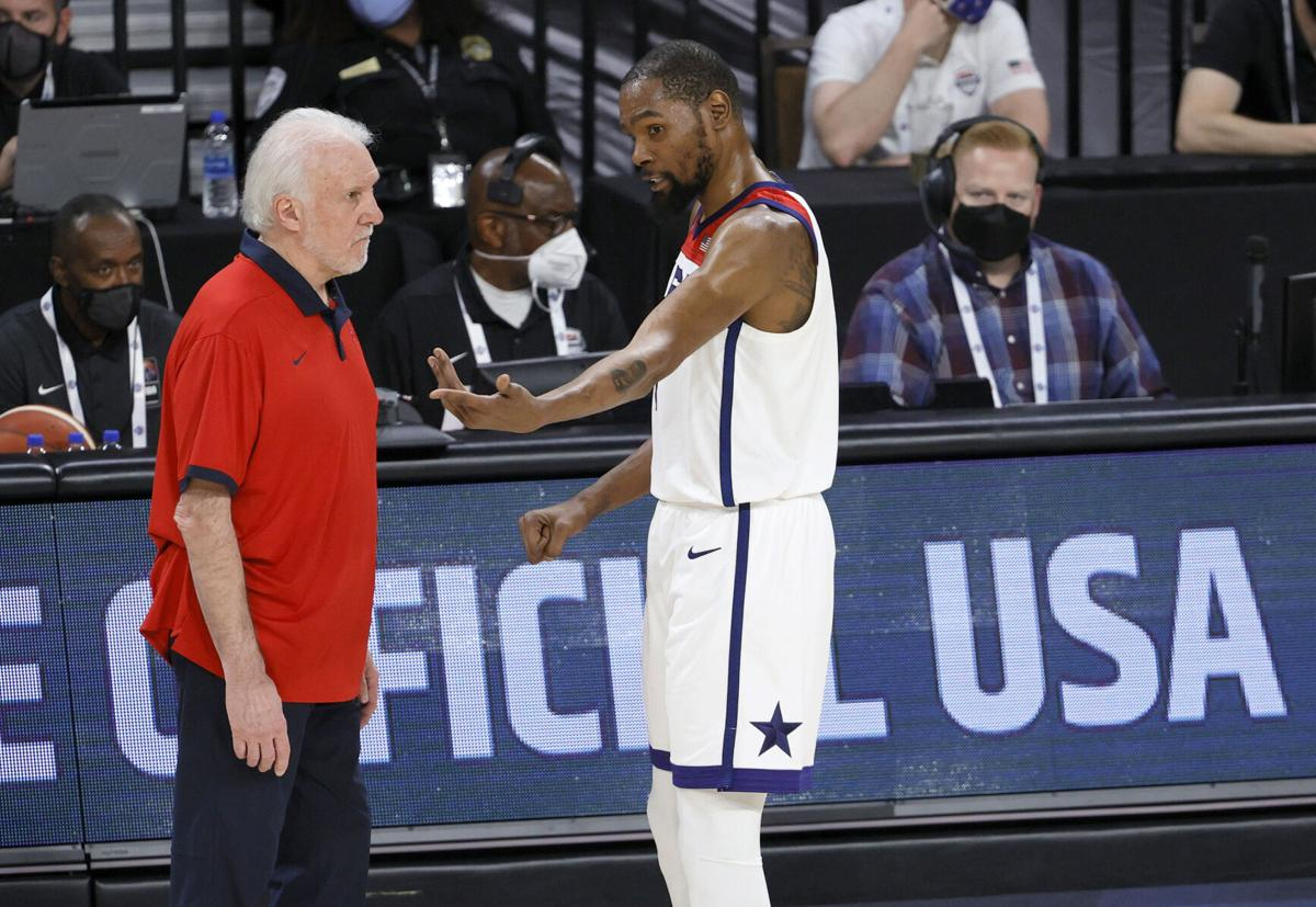 Head coach Gregg Popovich of the United States talks with Kevin Durant during an exhibition game against Nigeria at Michelob ULTRA Arena ahead of the Tokyo Olympics on Saturday, July 10, 2021 in Las Vegas, Nevada.