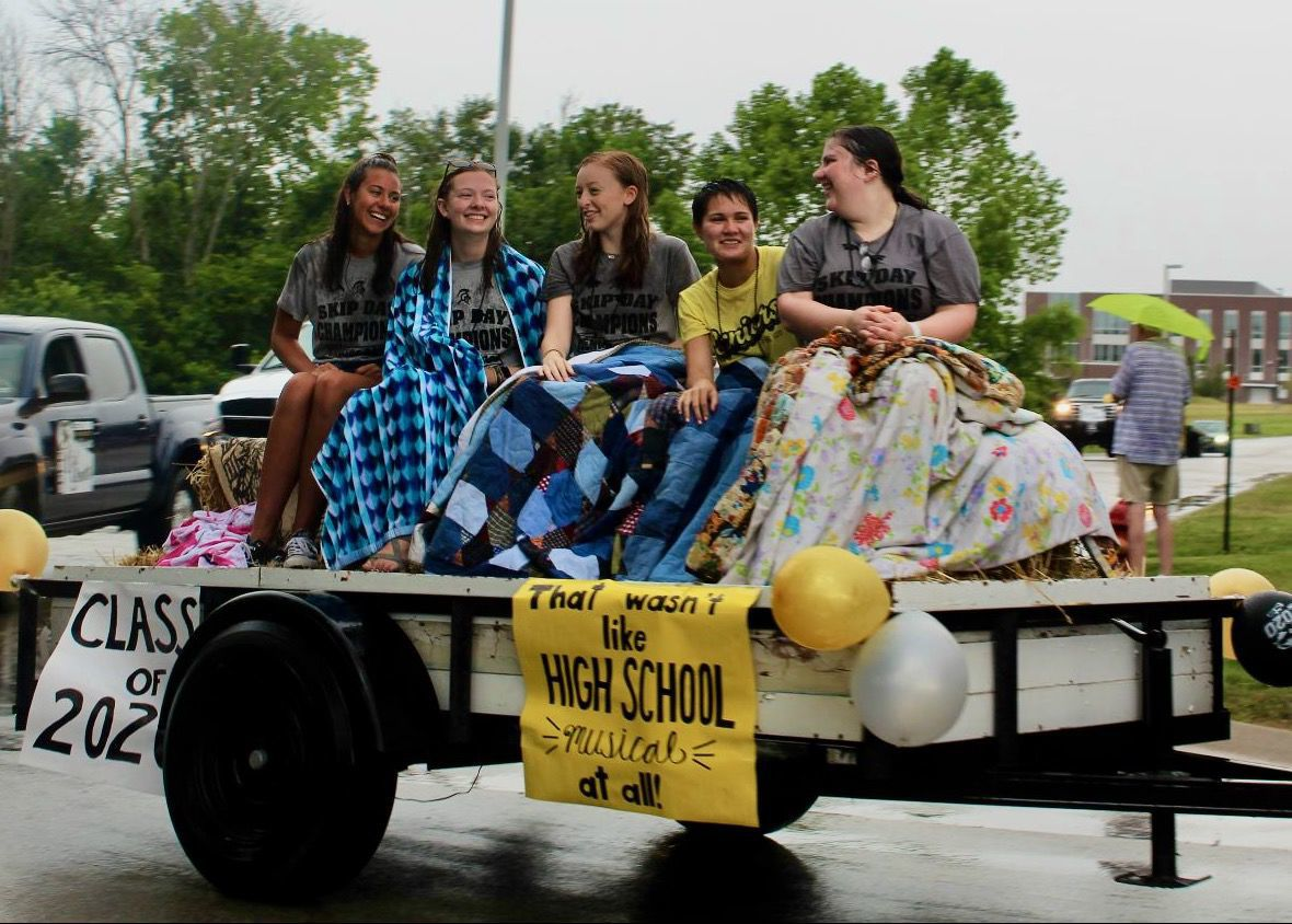 SOGGY SENIORS ENJOY GRADUATION PARADE