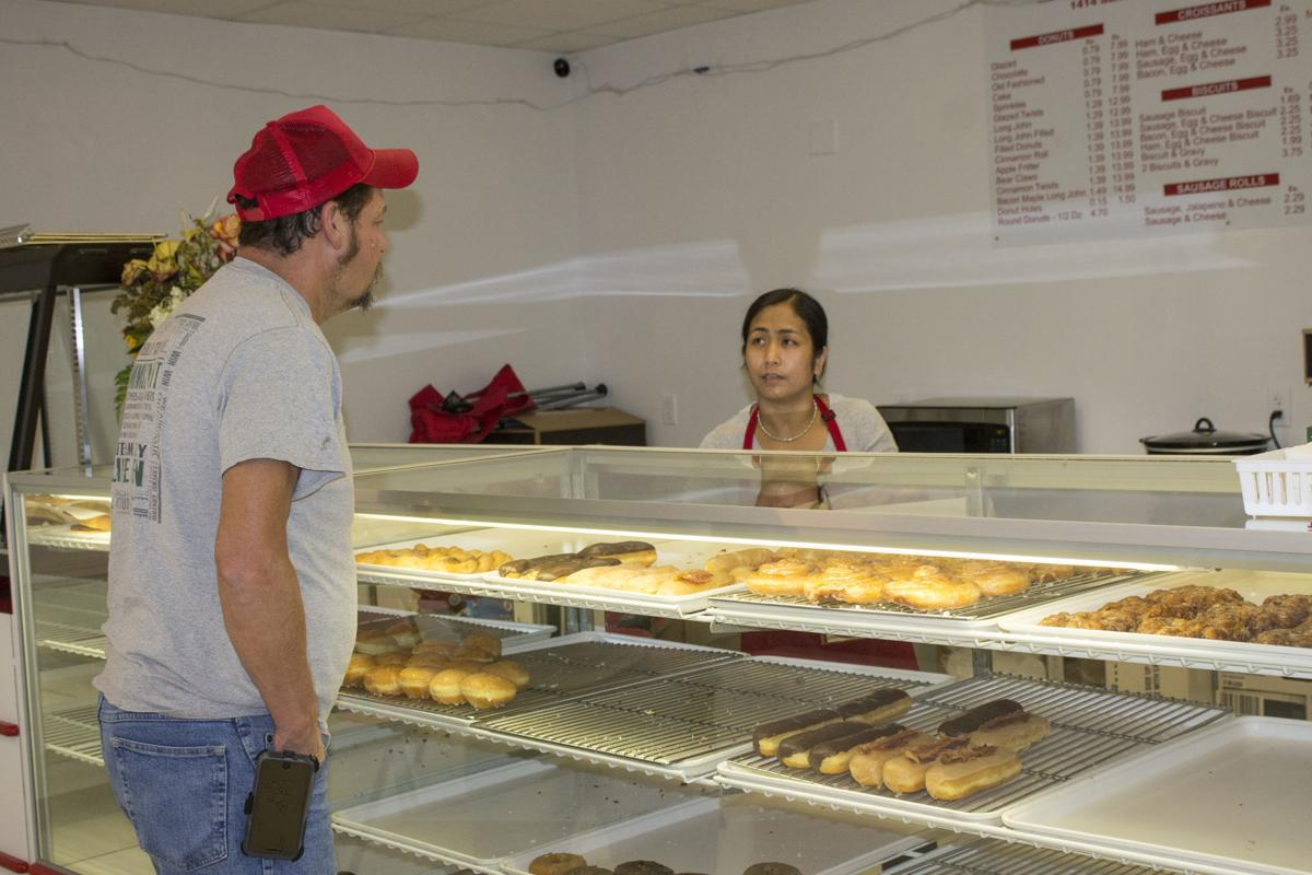 Donut Palace with customer Tooter Hall.jpg