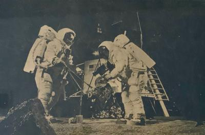 Men land on moon — and return