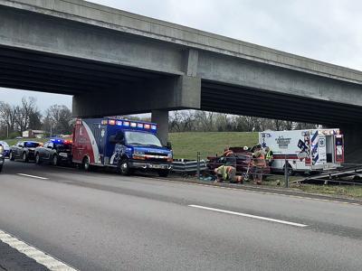 Woman hurt when car hits overpass