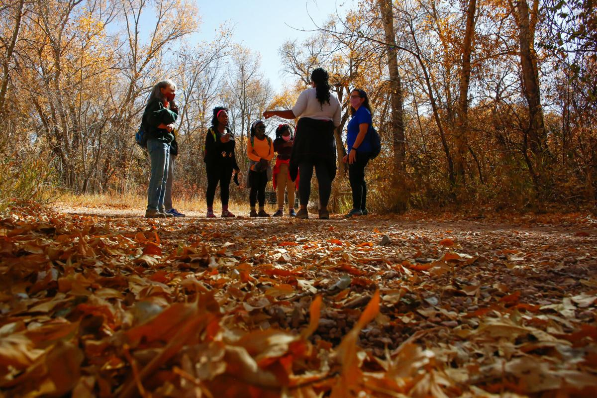 Members of Vibe Tribe Adventures pause during a hike through Bear Creek Regional Park in Colorado Springs, Colorado, on Oct. 24, 2020.